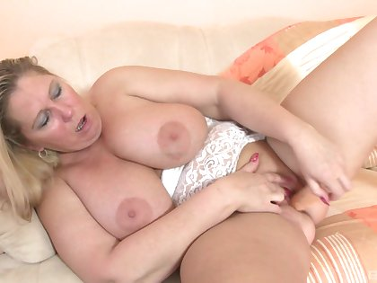 Busty blonde slut flashes her big boobs and plays with her pussy