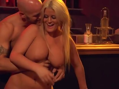 Julie Cash makes out yon younger stranger in the bar