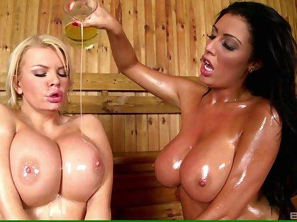 Tiffany Kingston and Ava Koxxx enjoying oily scissoring game round the sauna