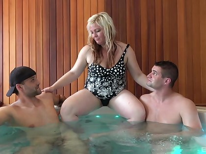 Tubby older broad Martina hooks up upon two studs beside the hot tub
